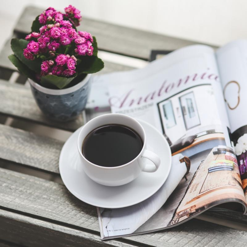 black coffee on the table with flowers