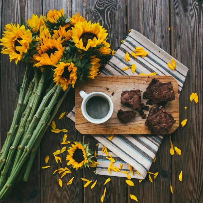 coffee cake and flowers on a wooden board