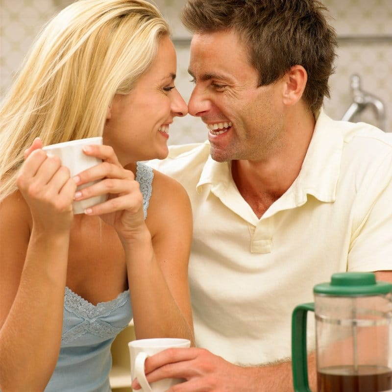 happy couple enjoying a cup of french pressed coffee