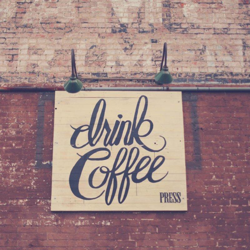 sign saying drink coffee press