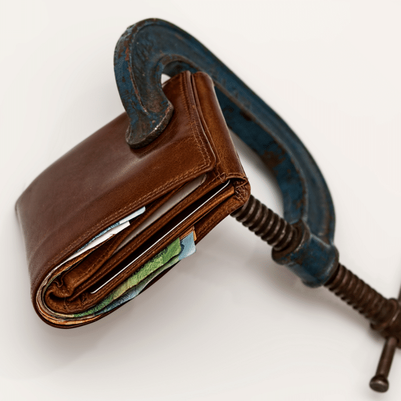 a clamp that is clamping down on a wallet
